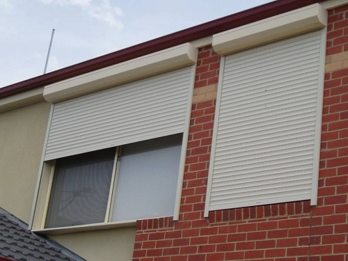 Insulated roller shutter doors and applications